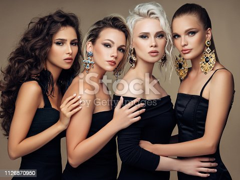 564586660istockphoto Four beautiful girls with make-up and hairstyle 1126870950