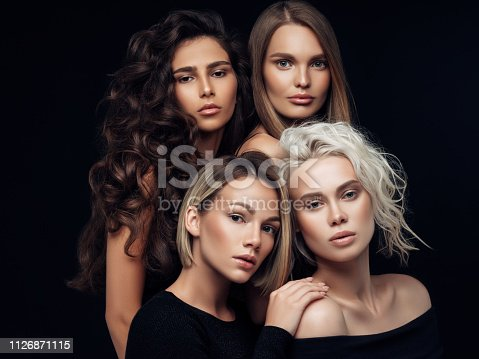 564586660istockphoto Four beautiful girls with make-up and hairstyle 1126871115
