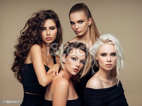 564586660istockphoto Four beautiful girls with make-up and hairstyle 1133210171
