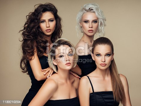 564586660istockphoto Four beautiful girls with make-up and hairstyle 1133210204
