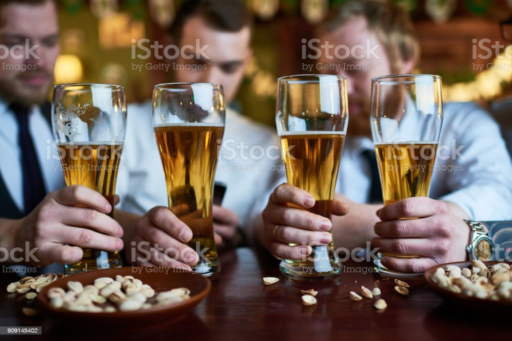 Four beer glasses for friends stock photo