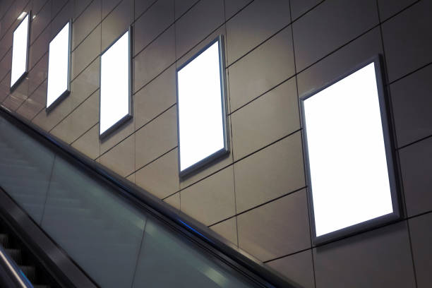 four big vertical / portrait orientation blank billboard with escalator background. - escalator foto e immagini stock