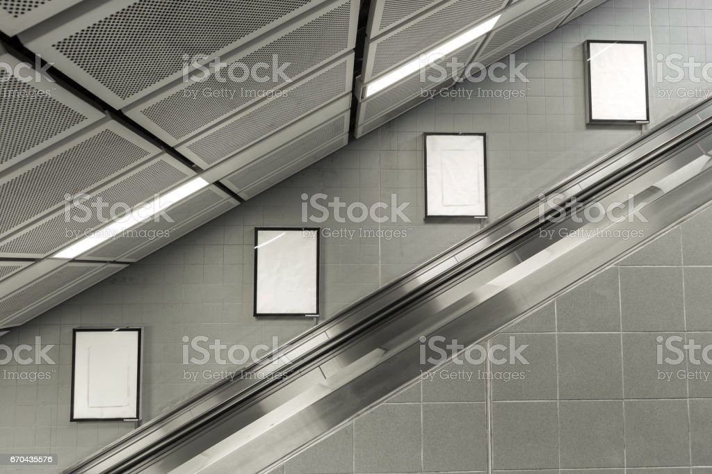 Four big vertical / portrait orientation blank billboard with escalator background. stock photo