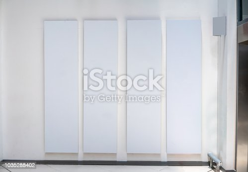 istock Four big vertical poster on white background in front of elevator 1035288402
