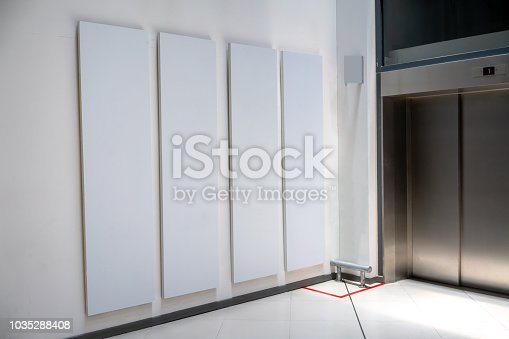 istock Four big vertical poster on white background in front of elevator 1035288408