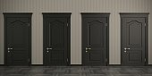 istock Four black doors on the wall 1128042324
