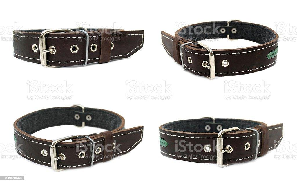Four black leather dog collars stock photo