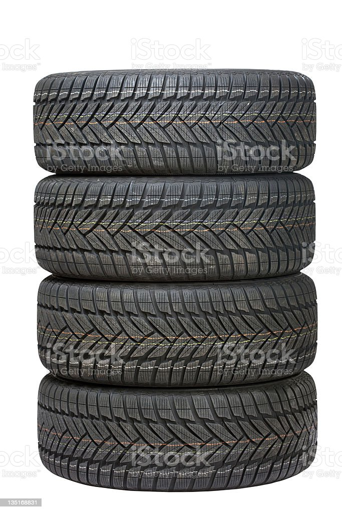Four black tires stacked on top of one another stock photo