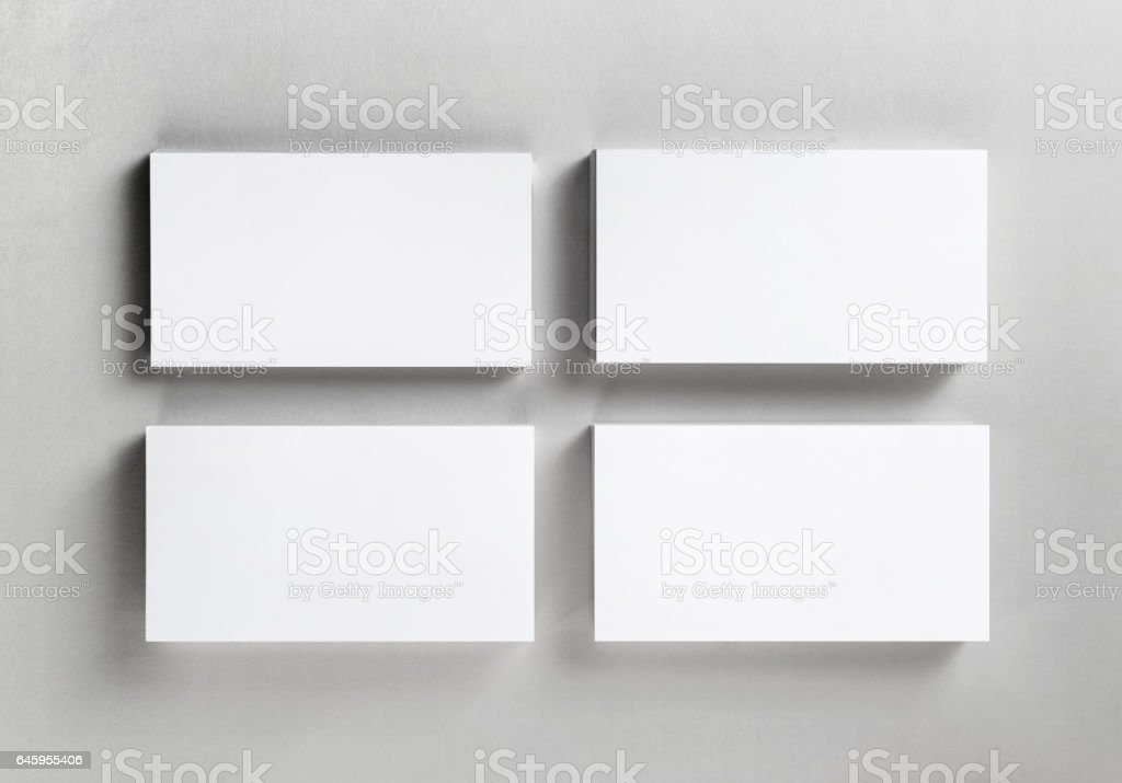 Four blank business cards stock photo