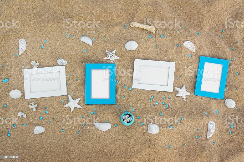 Four Blank Photo Frames On The Sand Beach With Decoration Royalty Free  Stock Photo