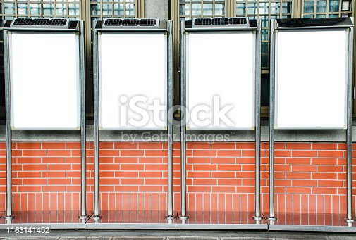istock Four blank picture frames on brick wall, Template Mock up for your content. For product display and advertising and promotional purposes 1163141452