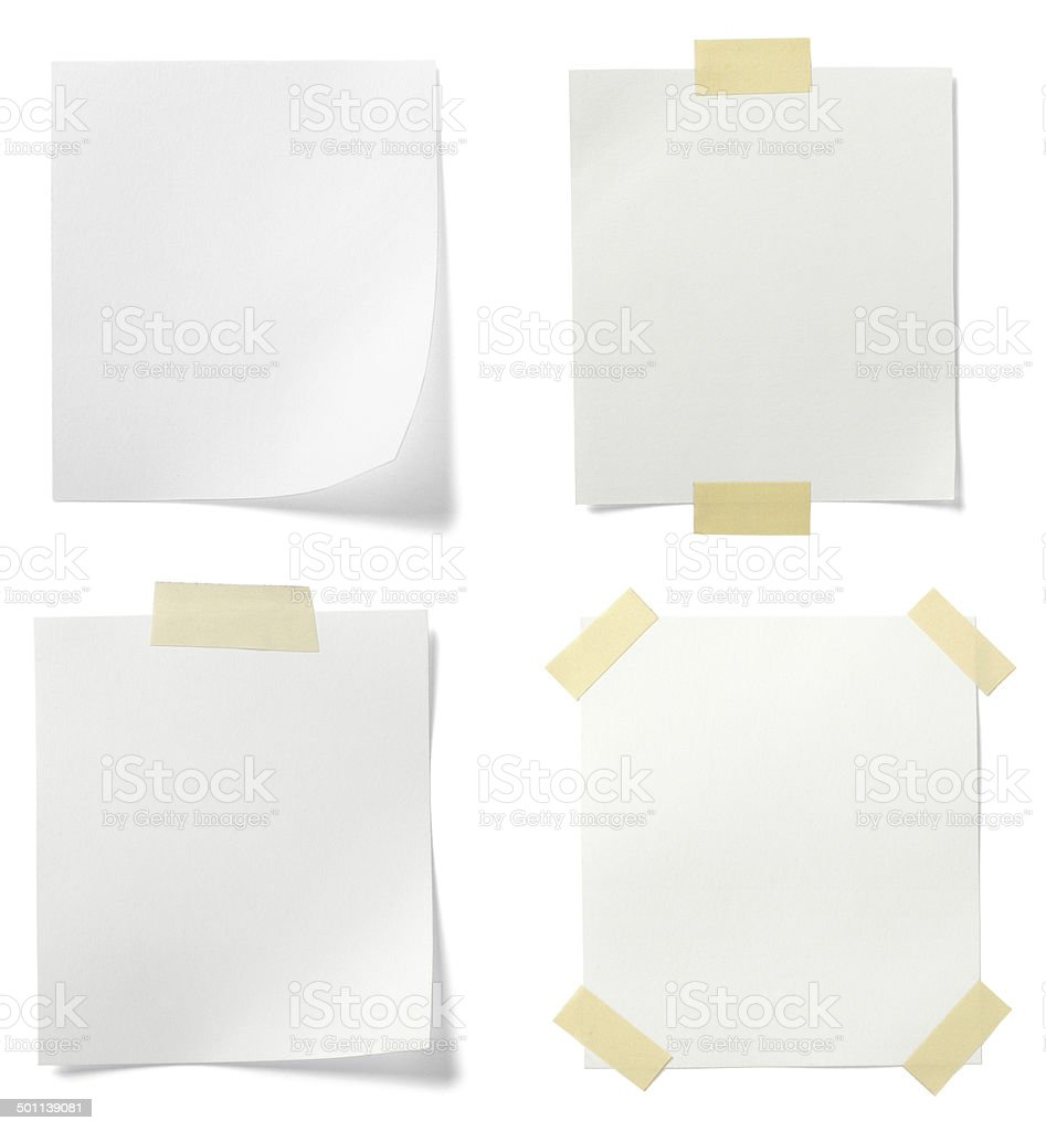 Four blank white pages taped to background stock photo