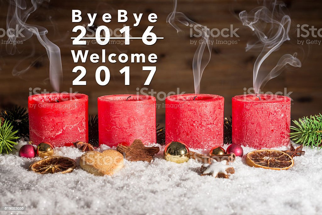 Four blown out candles with bye bye 2016 welcome 2017 stock photo