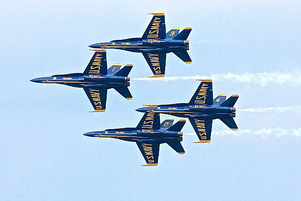 Four Blue Angels in flight formation stock photo