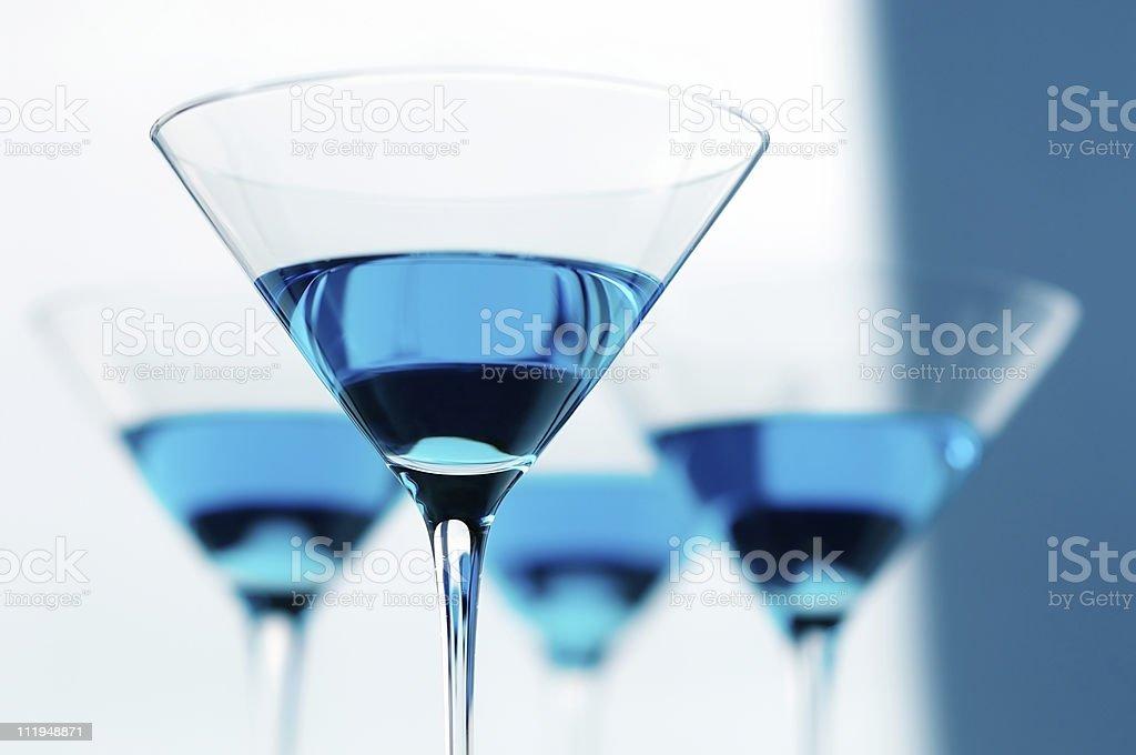 Four Blue Martini Glasses stock photo