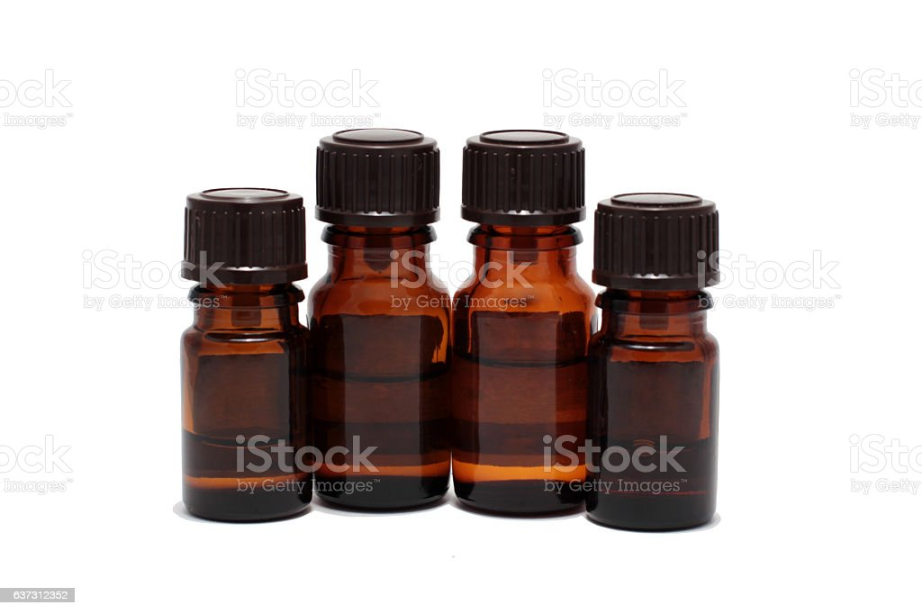 four bottles of aromatherapy oils isolated stock photo