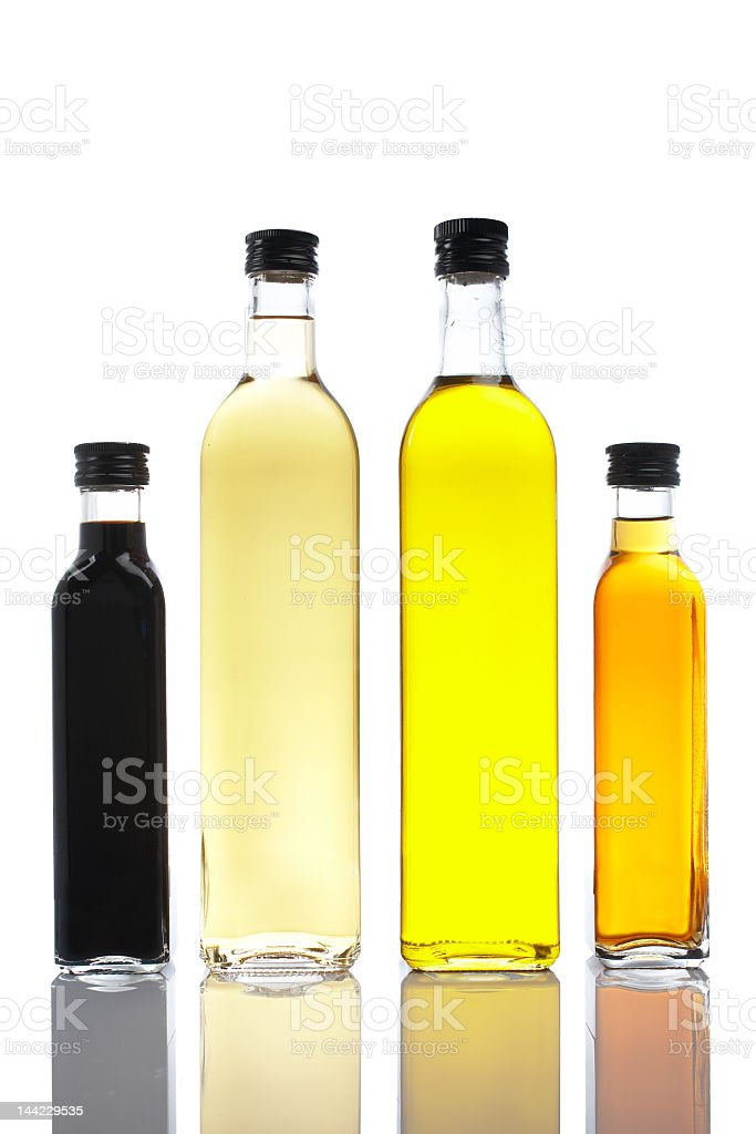 Four bottles of olive oil and vinegar with shadow  royalty-free stock photo