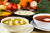 Assortment of vegetable soups Mixed vegetable soup tomato soup potato and leek soup and pumpkin soup