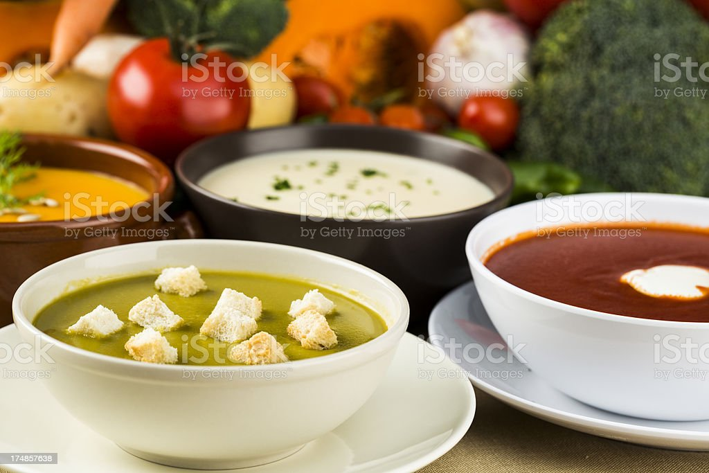 Four bowls of different vegetable based soups stock photo