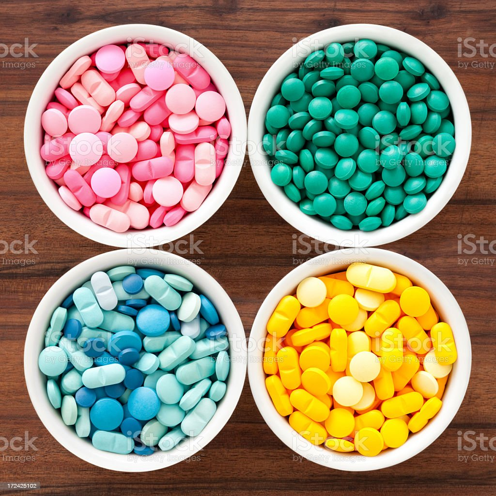 Four bowls with pills royalty-free stock photo