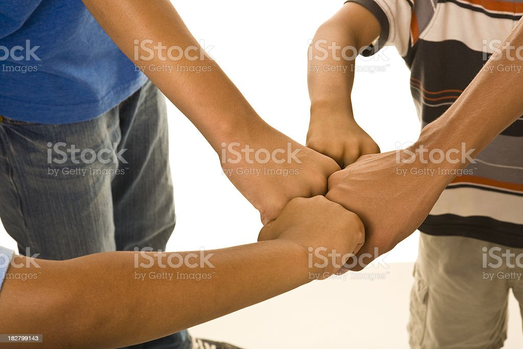 Four boys fist to fist, close up of fists royalty-free stock photo