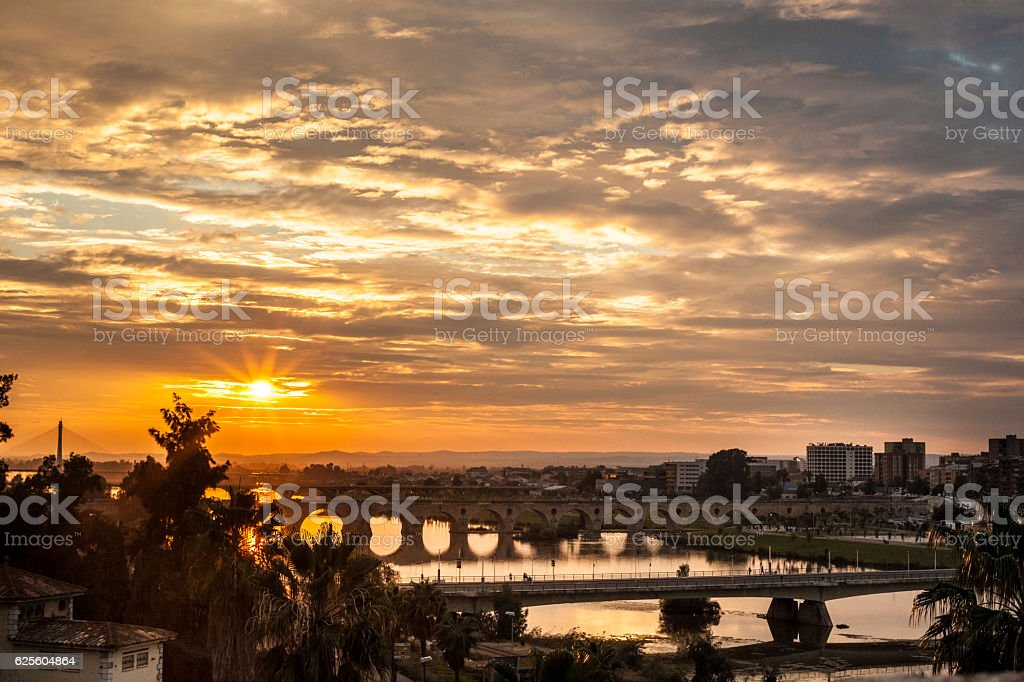 Four bridges of Badajoz City at sunset with cloudy sky stock photo