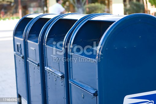 A row of blue mailboxes.