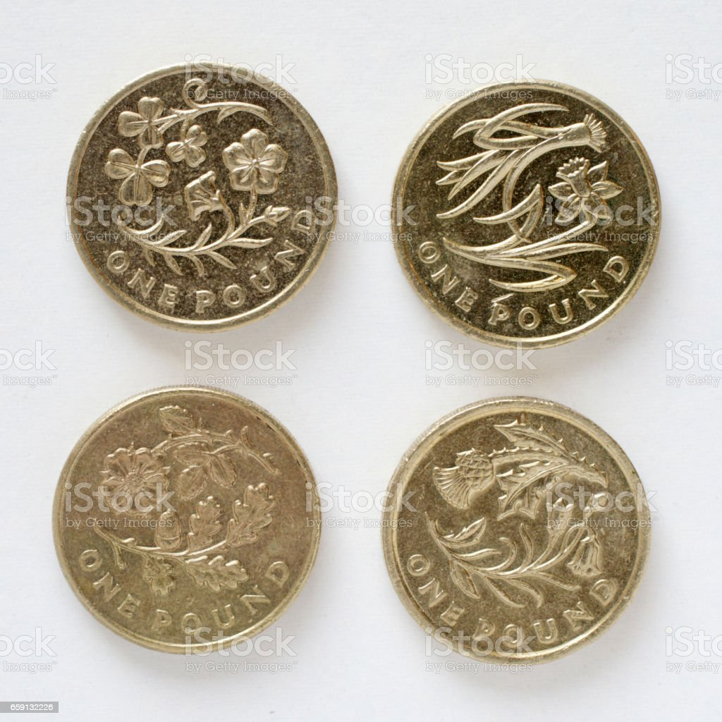 Four British pound coin designs national flowers stock photo