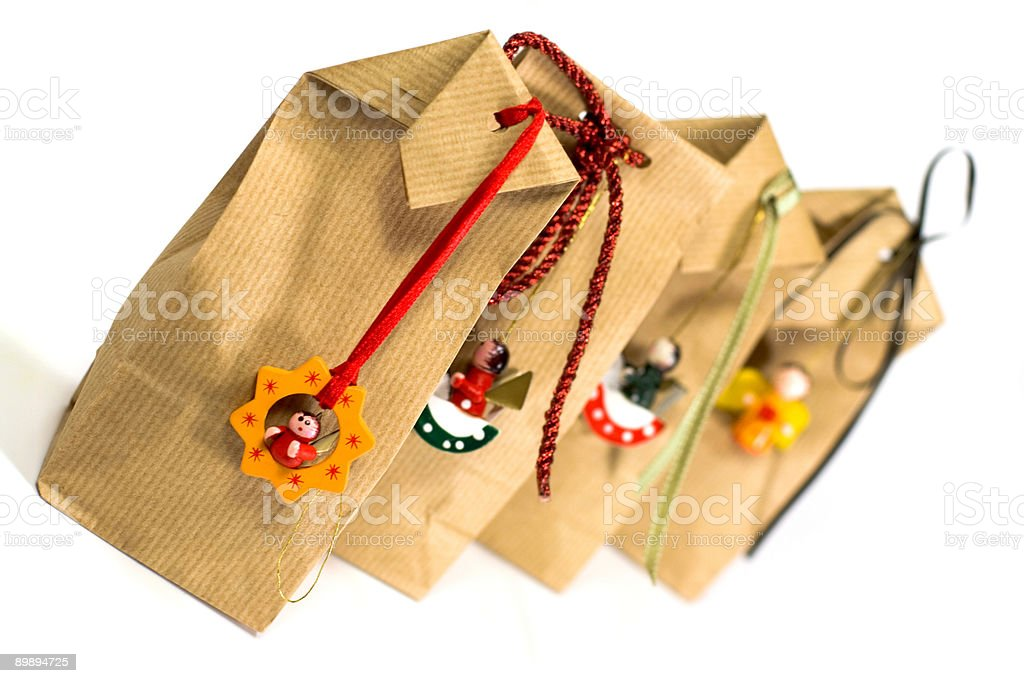 four brown gift bags royalty-free stock photo