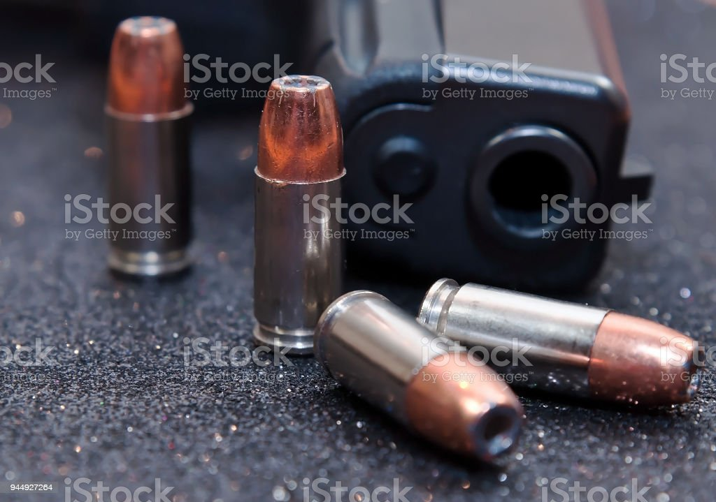 Four bullets and a black pistol stock photo