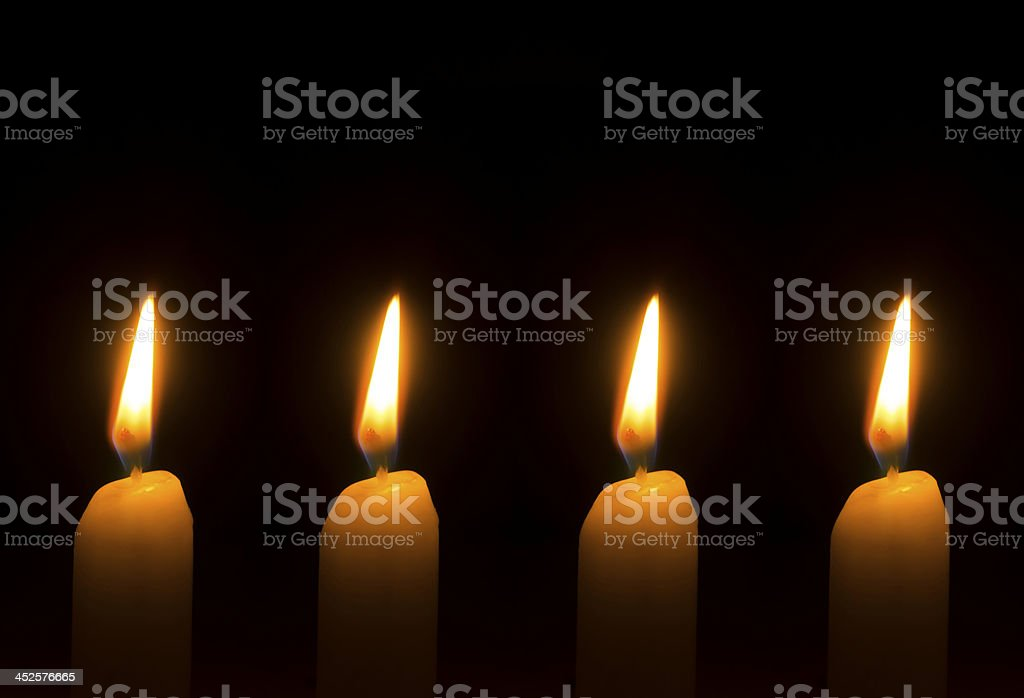 Four burning candles for Advent - Christmas stock photo