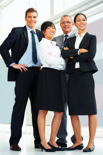 514325215 istock photo Four business people standing together 144955709