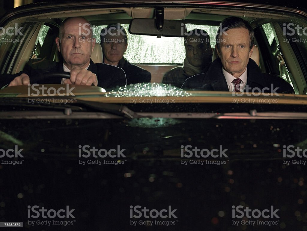Four businessmen sitting in car royalty-free stock photo