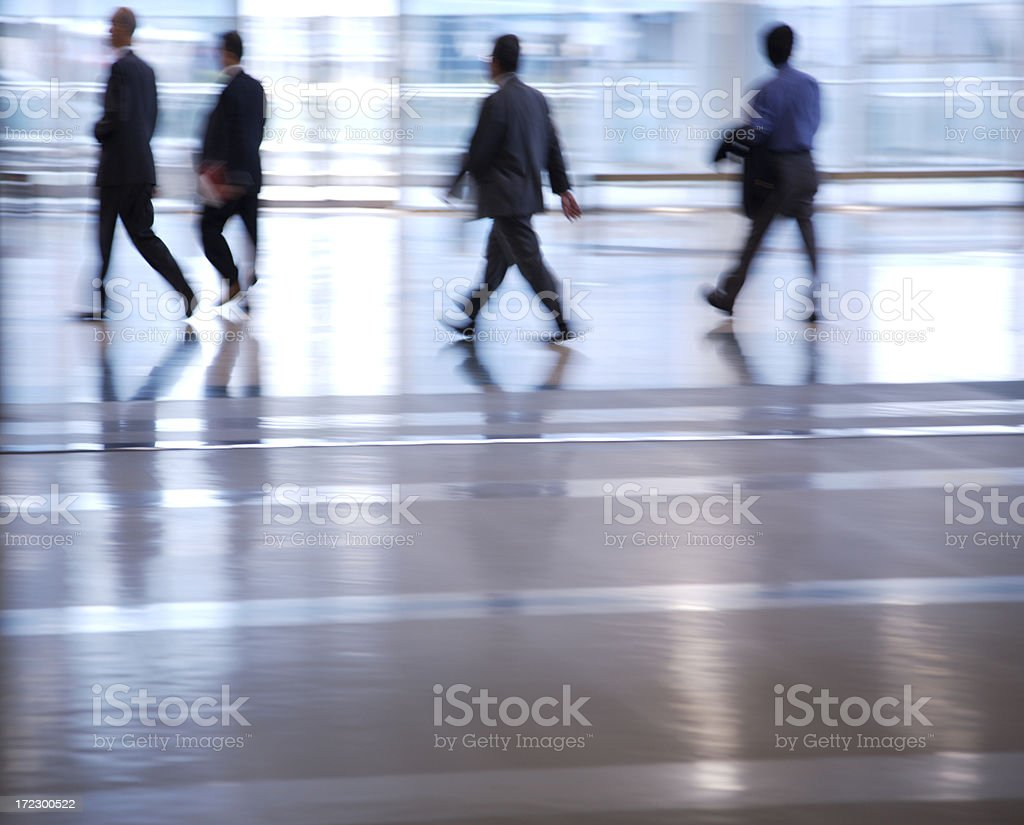 Four businessmen walking royalty-free stock photo