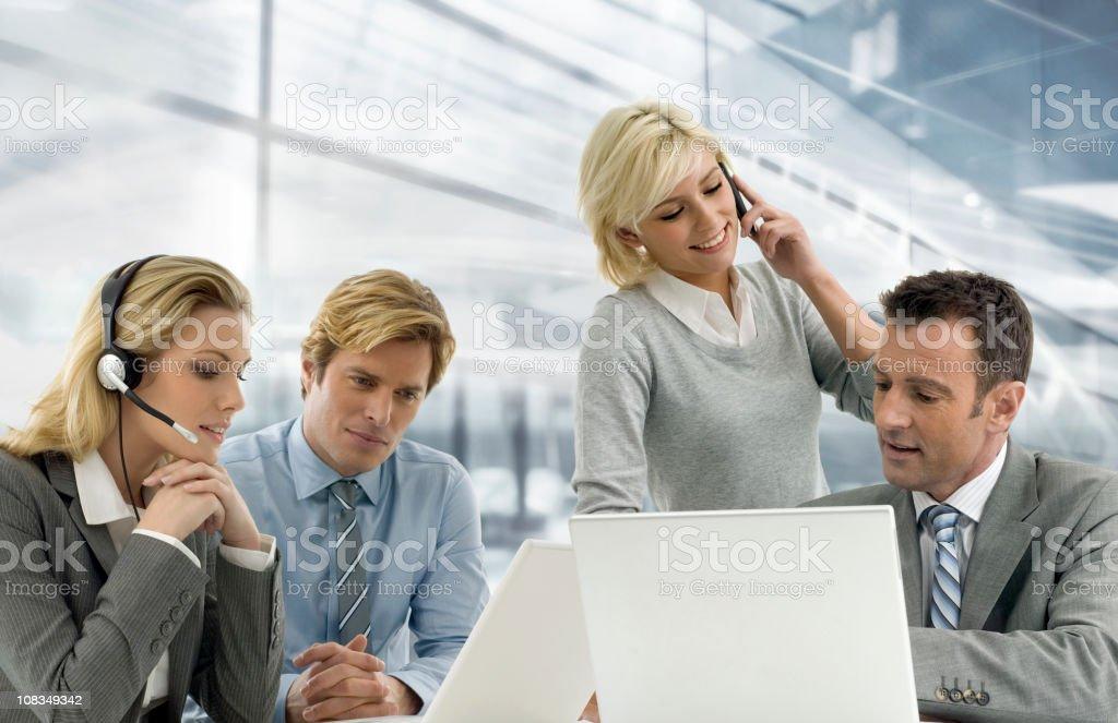 Vier Geschäftsleute – Foto