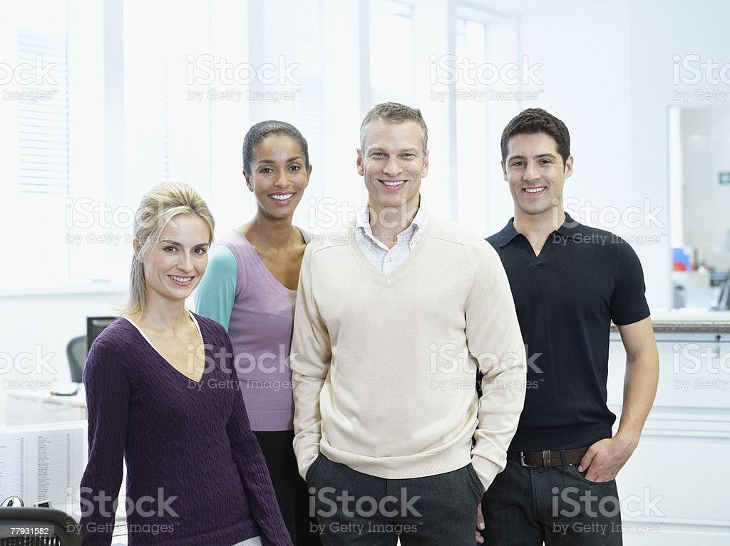 Four businesspeople standing in an office royalty-free stock photo