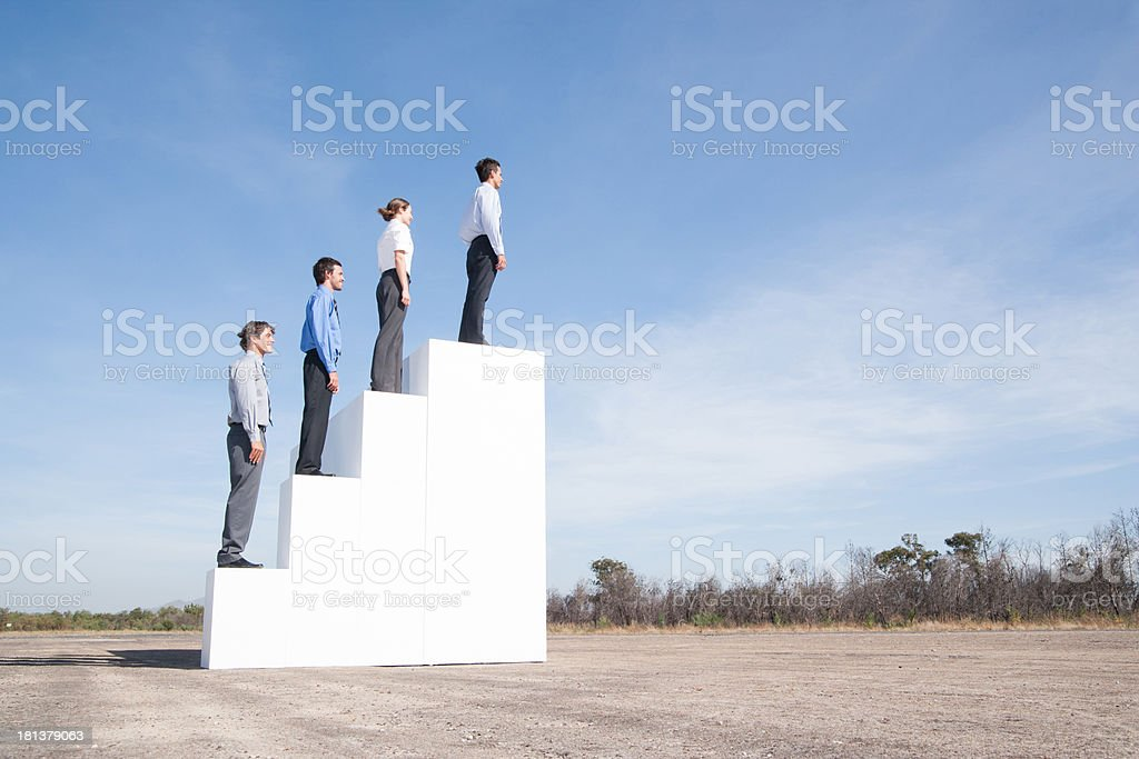Four businesspeople standing on steps outdoors royalty-free stock photo