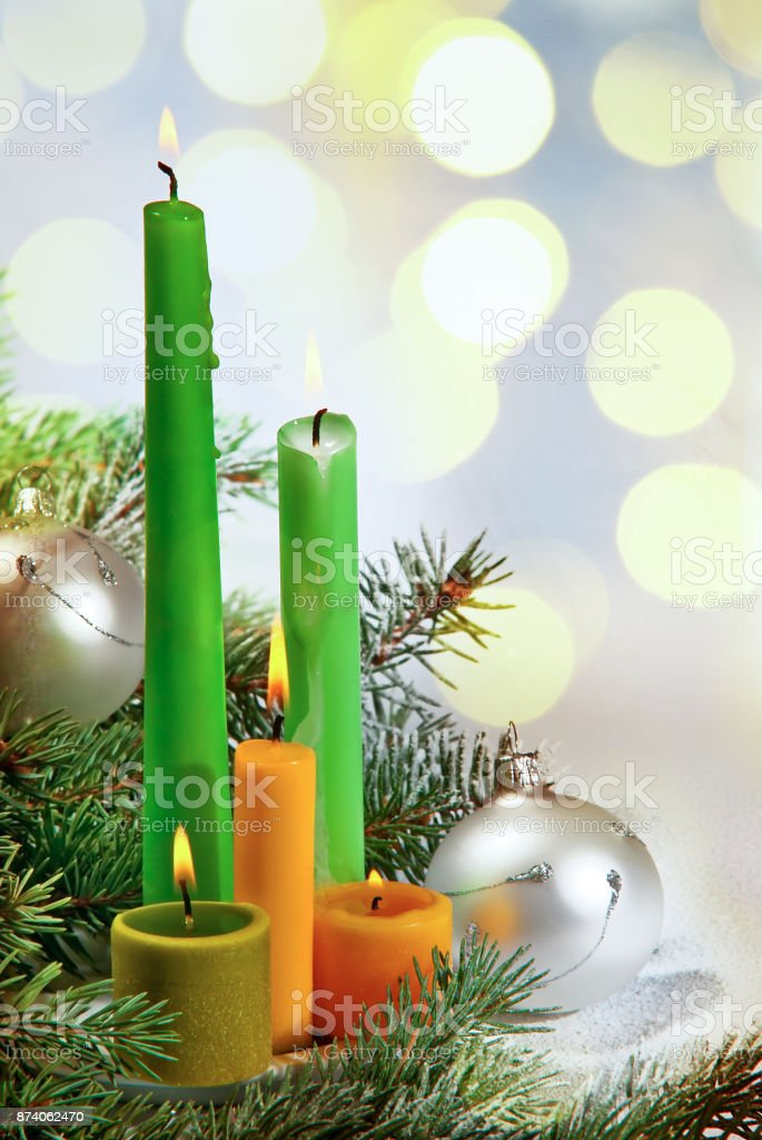 Four Candles with Christmas Twig on the White Background stock photo