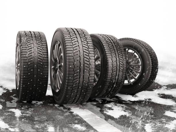 cuatro neumáticos del coche en una carretera cubierta de nieve. - tires fotografías e imágenes de stock