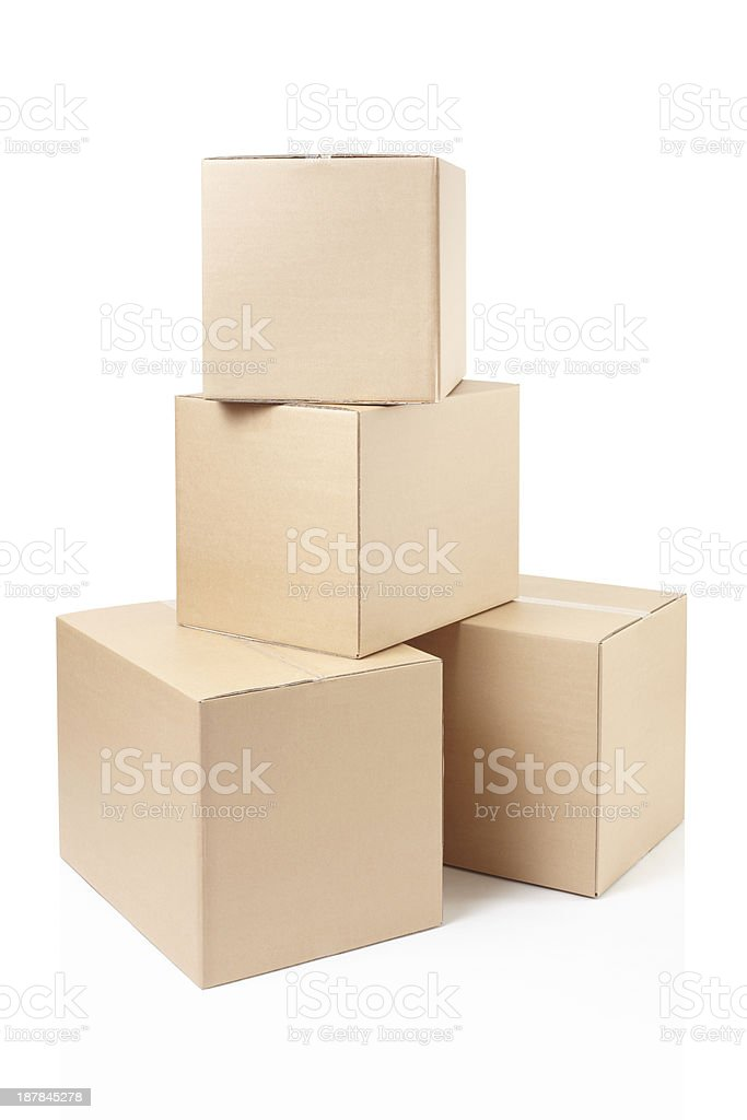 Four cardboard boxes stacked in a pyramid shape stock photo