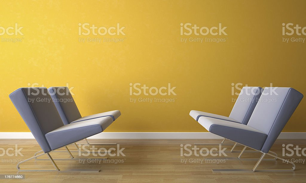four chair on yellow wall royalty-free stock photo