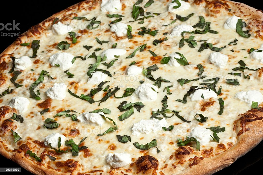 Four cheeses and basil white Pizza stock photo