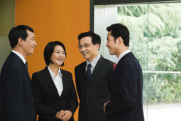 Four chinese business colleagues stock photo