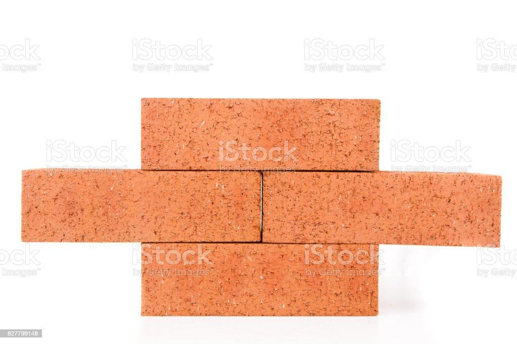 Four clay bricks building a wall stock photo