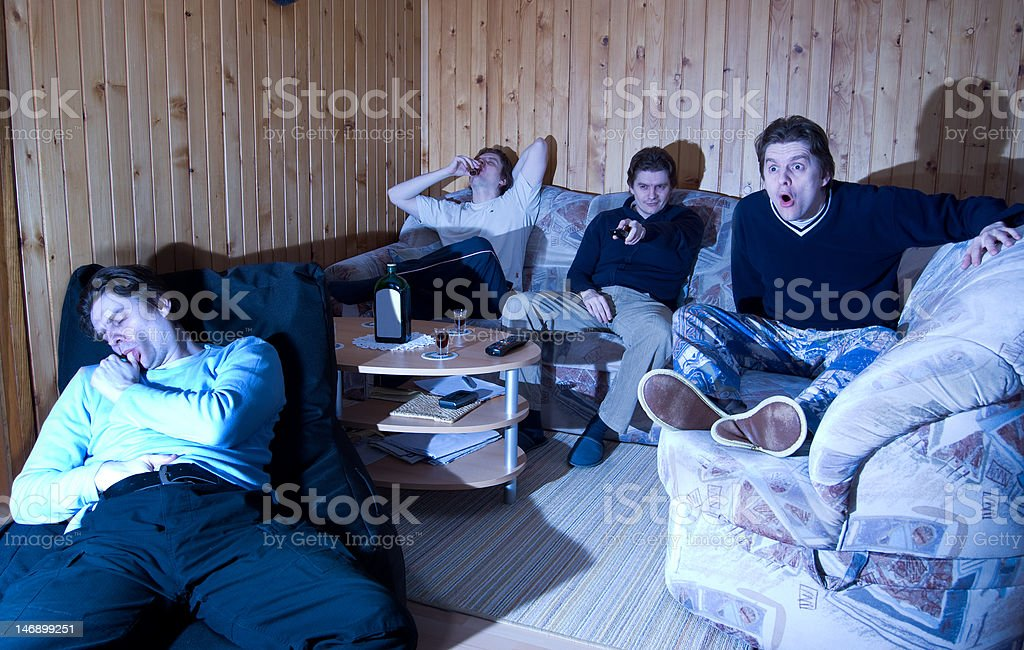 Four clones watching movie at home stock photo