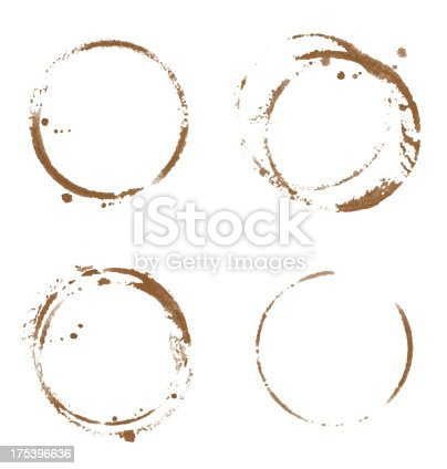 Four coffee cup stains isolated on white