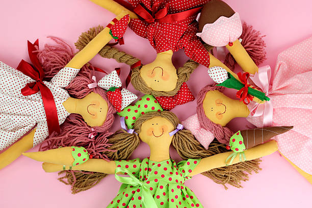 Four collector rag dolls stock photo