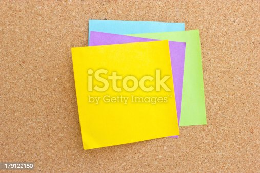 istock Four color sticky note on board. 179122180