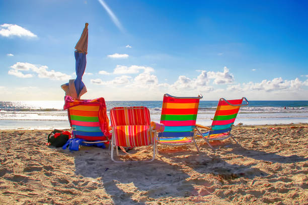Four colorful beach chairs in San Diego, California stock photo