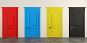 istock Four colorful doors on the wall 1128042328